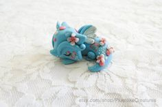 Tiny Polymer Clay Blue Dragon Figurine by PlushlikeCreatures by plushlikecreatures on Instagram   pinned by @weememories - Jenny Suchin