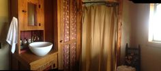 12 x 20 cabin furnished with antiques including stained glass window, clawfoot tub, lion's foot bed, 1920's toilet, sink base/closet  Also has ten gallon water heater, window a/c and electric wall heater, refrigerator, micowave and hot plate. Tub has hand held shower.  bed does not have mattress or springs. Last picture of tub is before…