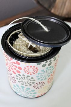 Use a paint can to store twine--poke a hole in the lid to pull out as needed.  Could also use oatmeal containers for this, as well.
