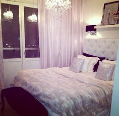 White and silver theme bedroom. White quilted headboard. Elegant x