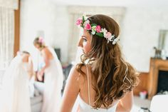 Bride wears a silk flower crown. Photography by Lisa Carpenter