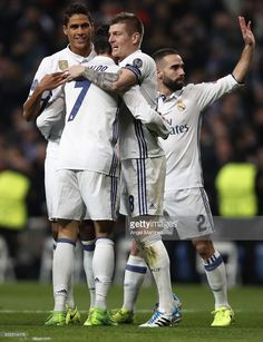 Toni Kroos (2nd R) of Real Madrid celebrates with Cristiano Ronaldo (2nd L) and Raphael Varane (L) after scoring their team's second goal during the UEFA Champions League Round of 16 first leg match between Real Madrid CF and SSC Napoli at Estadio Santiago Bernabeu on February 15, 2017 in Madrid, Spain.