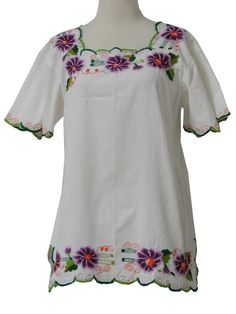70s -Creaciones Mario, Mexico- Womens white cotton broadcloth trimmed with multicolored floral machine embroidery at neckline, hem and cuffs, butterfly short sleeve pullover hippie shirt with square neckline, dart semi-fitted, side slits (loose threads and a worn scallop)