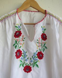 Boho Floral Embroidered Peasant Top. $65.00, via Etsy.