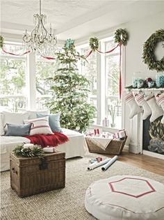 Ribbon and olive leaf wreath garland; gifts in basket. I think this is my favorite Christmas decorated room ever!
