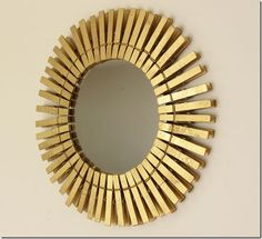 clothespin starburst mirror using supplies from dollar tree via http://inmyownstyle.com/2011/04/a-fun-take-on-a-starburst-mirror.html