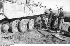 Repairs crews performing repairs to a very muddy Tiger 1 in field conditions