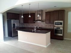 Granite throughout in the kitchen with an open view to the family room, great for entertaining guests.