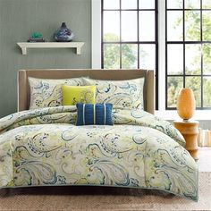 The Tamira collection will provide a fresh look to any bedroom. The comforter and sham features a colorful, watercolor paisley printed on microfiber fabric in soft grey and brown with pops of chartreuse green and blue on a soft neutral ivory ground color. The set includes two decorative pillows to complete the look.