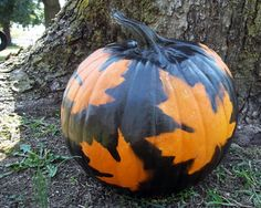 Pin leaves to a plastic pumpkin then spray paint to decorate!