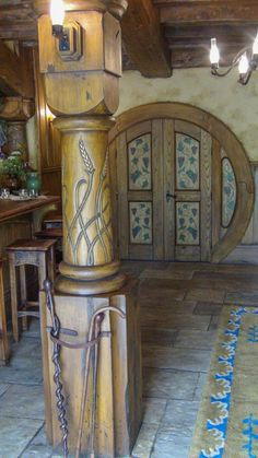 Hobbit hole interior, oak and ivy pattern painted on door.