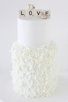 Wee Love Baking: all white wedding cake with white scrabble topper