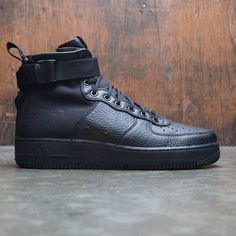 00acc89a75c A hoops icon toughens up with the Men s Nike SF Air Force 1 Mid Shoe.