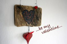 Heart handpainted on driftwood with vintage metal by Yalos on Etsy, $49.90