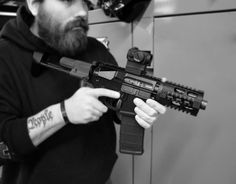 It's called the CHODE (Close HOme DEfense) upper. It's a DI upper. I've seen estimates of FPS. Other than the super low FPS, I like it, and it's just BEGGING to be fired from inside a car. :twisted: :clap: They're selling them on Gunbroker. Airsoft Guns, Weapons Guns, Guns And Ammo, Shotguns, Ar15 Pistol, Ar Rifle, Tactical Gear, Tactical Knife, Tactical Firearms