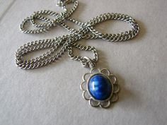 Vintage silver and dark blue flower necklace on Etsy, $10.00