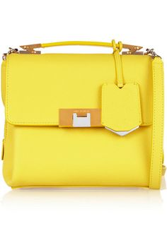 Balenciaga's lemon textured-leather 'Le Dix' shoulder bag will add a zesty pop to everyday outfits. Though it looks small, this structured style opens to three compartments – one of which is zipped – to keep things neat. The optional shoulder strap means you can switch up your styling. Shop it now at NET-A-PORTER