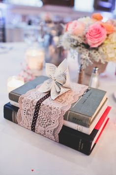 Perfect centerpieces for a vintage book theme wedding. The more eclectic, pinks, creams, books, lace, sheet music, vintage the more I will LOVE it!