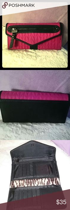 "Nicole Miller Wallet EUC This is a gorgeous NM wallet which holds 11 cards + ID window. The zipper front is just for show. Full zipper coin pocket inside with the NM signature animal lining. Polyester & PU easy clean but looks like leather. Very functional & goes great with any black bag and with the pop of color won't get lost in those big bags! Measures 8"" wide by 4"" high. The color is fuschia pink with black. Reasonable offers welcome or bundle with a black bag for 30% discount! Nicole…"