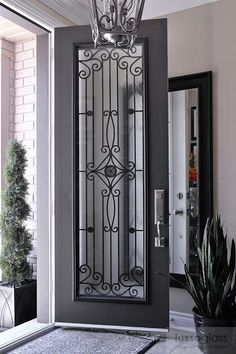 Timber and wrought iron front entry door idea...