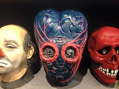 A custom painted pull by Rob Tharp from the Don Post Studios Metaluna Mutant production mold originally sculpted by Bill Malone. -The Crimson Ghost Mask Room 2015