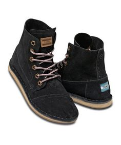 Enjoy two distinct looks in one stylish pair of TOMS. The military-inspired Tomboy is designed to be worn with the collar up around the ankle or flipped down for a casual vibe. The molded, removable footbed offers superior comfort and support, and gussets at the ankle mean laces can be loose and this boot will still stay snug. And with the purchase of every pair of TOMS shoes, another pair is given to a child in need somewhere in the world. Size note: TOMS run true to size.