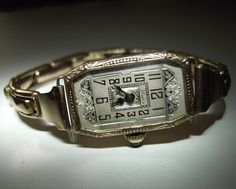 9k yellow gold, ornate cased 1920's Art Deco styled ladies manual wind watch