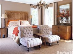 In the master bedroom of a comfortable family house, an antique door is the headboard.