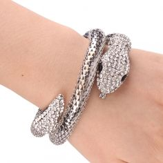 Sssssuper Snake bracelet will get TONS of compliments ! buy yours now ! bids of $20 or more get a free gift.   Material Alloy, Rhinestone   Color Silver   Inner Diameter 2.13 inch   Outer Diameter 2.76 inch   Width 0.75 inch  starting bid $10
