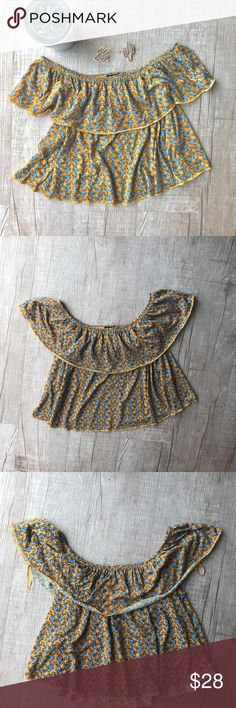 """TOPSHOP Paisley Cropped Off the Shoulder Top * TOPSHOP Cropped Off the Shoulder atop * Paisley Print  * yellow/orange  * BUST (laid flat, on one side) - 16"""" * LENGTH - 15"""" * 100% Polyester  * great used condition   * no trades/paypal/off site transactions * all measurements are approximate Topshop Tops Crop Tops"""