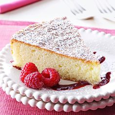 Almond Cake with Raspberry Sauce Recipe -This cake is simple, but is delectable and looks elegant. The cake is very moist with great flavor. The drizzle of raspberry sauce, not only adds to the enjoyment of the dessert, but it looks beautiful on the plate. —Joan Sullivan, Gambrills, Maryland
