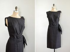 vintage 1950s, early 1960s black raw silk cocktail dresss, sleeveless with gathered silk applique at one shoulder and asymmetrical draped and swag