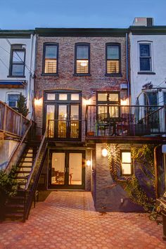 Downstairs doors, open up the back of the house--The back of this Brooklyn brownstone features a quaint staircase and patio accented by clean black lines and a charming brick exterior. Brooklyn House, Brooklyn Nyc, Future House, My House, House Front, Traditional Exterior, Traditional Decorating, Traditional Furniture, Facades