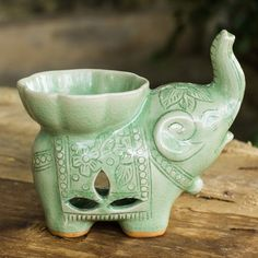 NOVICA Handmade Light Green Celadon Ceramic Elephant Oil Warmer ($50) ❤ liked on Polyvore featuring home, home decor, home fragrance, green, incense and oil burners, lamps and lighting, home scents, elephant oil warmer, elephant candle warmer and wax burner