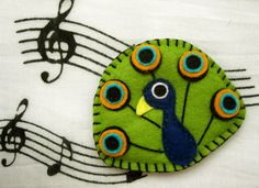 Amadeus the peacock - felt brooch or magnet, animal brooch or magnet by mirkajakabova on Etsy https://www.etsy.com/listing/161554566/amadeus-the-peacock-felt-brooch-or