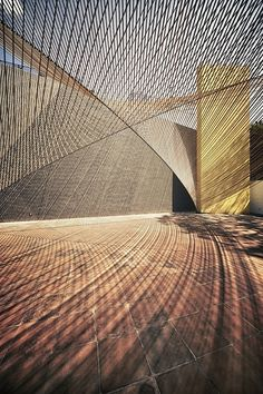 Eco Pavilion, Mexico City by MMX - light tension elements soften the hard stone tiles