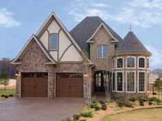With a touch of Tudor-influenced style, plan DHSW64224 stands out. Inside that turret? A dining room that's ready to host an elegant evening. See more photos at http://www.dreamhomesource.com/house-plans/dhs/dhsw64224.html