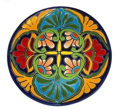 Enjoy the vibrant colors in this handmade round plate, decorated with floral patterns and a cobalt blue border. Whiskey Blue, Talavera Pottery, Circular Pattern, Decorative Storage, Hand Painted Ceramics, Ceramic Painting, Ceramic Plates, Diorama, Dinnerware