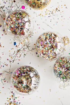 Glitter-filled ornaments are DIY, and totally adorbs.