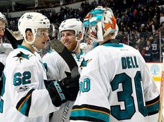 WINNIPEG, MB - JANUARY 24: Kevin Labanc #62 and Joe Pavelski #8 of the San Jose Sharks congratulate goaltender Aaron Dell #30 after backstopping the team to a 4-3 victory over the Winnipeg Jets at the MTS Centre on January 24, 2017 in Winnipeg, Manitoba, Canada. (Photo by Jonathan Kozub/NHLI via Getty Images)