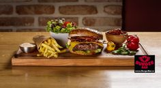 Chipotle - hovězí hamburger z mletého masa, chipotle papričky, jalapeño papričky, čedar, slanina, chipotle majonéza, rajče, salát