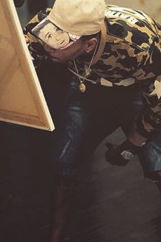 Chris Brown wearing  Bape 1st Camo Mesh Football Long Sleeve, Off-Brand Dee Cosey Custom Royalty Cap
