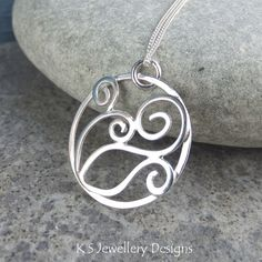 Sterling Silver Swirl Circle Pendant - HIDDEN FISH - Handmade Metalwork Wirework £36.00