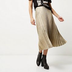 SHOP River Island Gold metallic pleated midi skirt  I am in love with pleated metallic skirts this winter, team with a casual tee for dressed down glam!