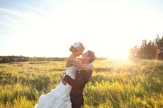 Gotta love wedding photos in a field! Beautiful lens flare as well!