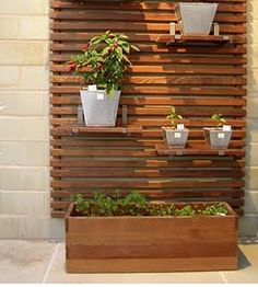 outdoor slat wall + planter boxes or shelves.