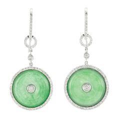Pair of White Gold, Jade and Diamond Pendant-Earrings   18 kt., 2 jade discs ap. 17.0 mm.