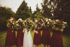 Sunflower Wedding Bouquet Rustic Wedding With Wes Anderson Fantastic Mr Fox Them. Sunflower Wedding Bouquet Rustic Wedding With Wes Anderson Fantastic Mr Fox Them… Sunflower Wedding Bouquet Rustic Wedding With Wes Anderson Fantastic Mr Fox Theme With Red Bridesmaids, Rustic Wedding Dresses, Wedding Bridesmaid Dresses, Wedding Bouquets, Wedding Flowers, Rose Wedding, Maroon Wedding, Purple Wedding, Wedding Colors
