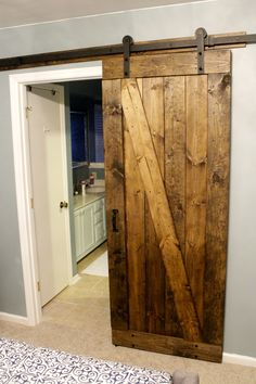 We decided to hand build a barndoor to hang between the baster bedroom and bathroom. There were so many doors right there that banged into each other, the sliding bard door solved that problem. It is also a beautiful piece!