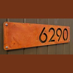 "The Modern and Sleek house number sign made from16ga rusted steel. Sealed 20"" X 5"" I LIKE THIS particular execution of the cut out approach A LOT"